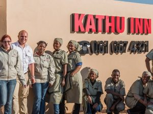 Kathu inn sign and employees